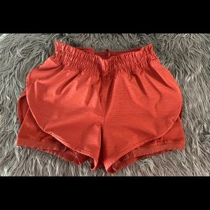 LULULEMON Copper Red Shorts w/spandex Size 10
